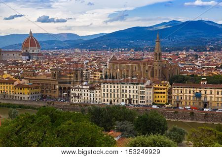 FLORENCE, ITALY - SEPTEMBER 2016: Arno river, Florence Duomo, Cathedral Santa Maria del Fiore, Basilica di Santa Croce in evening, Florence, Italy on September 21, 2016. View from Michelangelo square