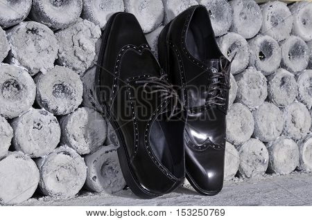 luxurious men's  shoes. Pair of stylish black leather shoes handmade, conceptual of original design quality and craftsmanship