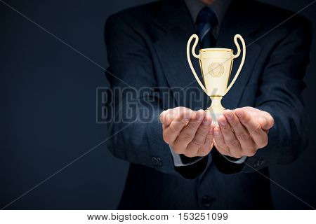 Business success, benchmarking and be number one on market concepts. Businessman hold cup representing success.