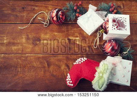 Christmas Composition with red balls on wooden table.
