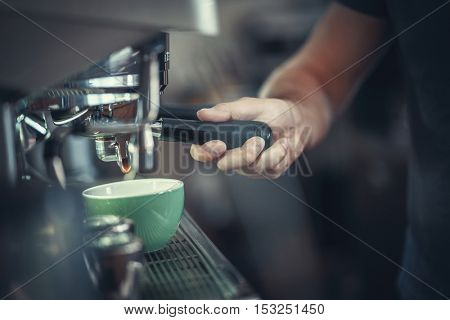 Male hands preparing coffee