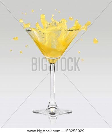Orange Juice Splashing Out Of Glass
