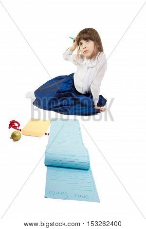Girl writing a very long letter to Santa. Isolated on white background. Vertical orientation.