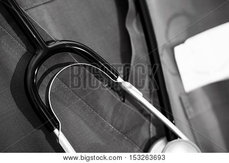Uniforms and attributes of the doctor. Conceptual black and white photo.