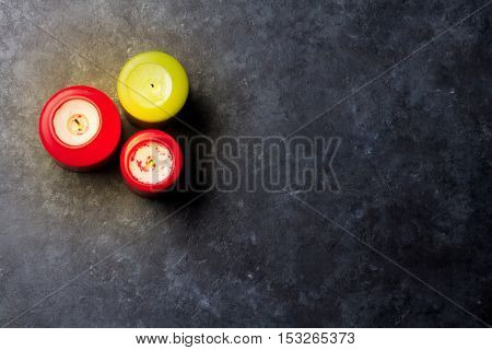Christmas candles on stone table. Top view with copy space