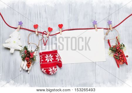 Christmas decor and greeting card on wooden background with copyspace