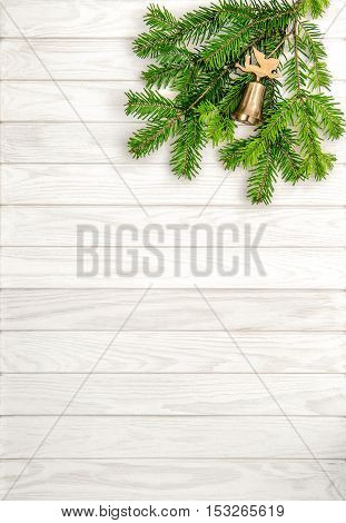 Christmas tree branches on white wooden background. Undecorated evergreen twigs