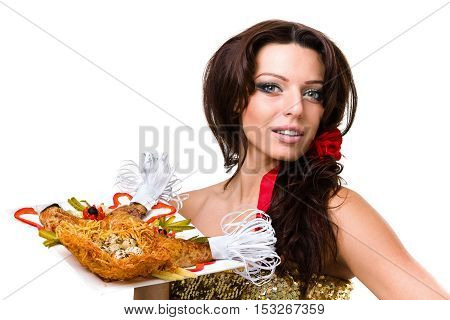 Woman hold plate with meat decorated with fruits and vegetables for dinner evening on white background