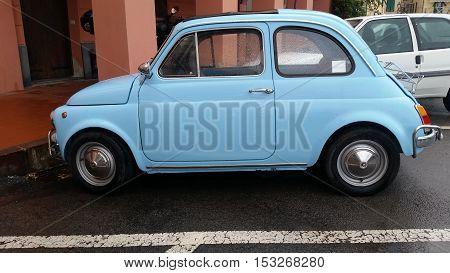 Ventimiglia Italy - October 23 2016: Small Italian Car Fiat 500 Parked on the Street of Ventimiglia. Blue Fiat 500 L