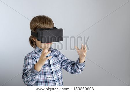 boy with glasses of virtual reality, the child tries new technology