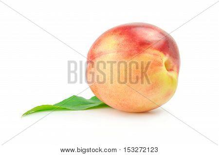 Nectarine fruit with leaf isolated on white background.