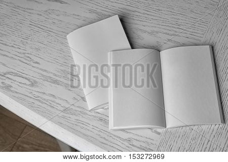 Blank brochures on wooden table