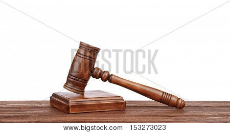 Judge's gavel with sound block on white background
