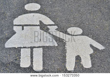 Street sign for pedestrians painted with white color over the asphalt