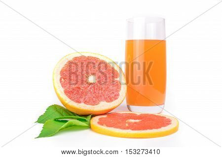 Grapefruit juice and ripe sliced grapefruit with leaves on white background.