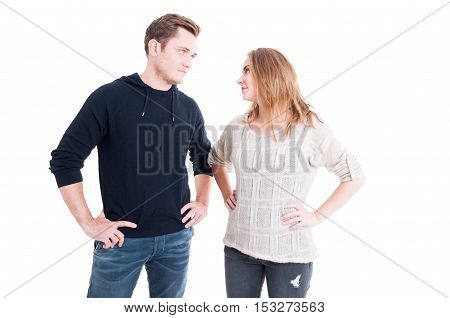 Couple Looking At Each Other With Arms On Hips
