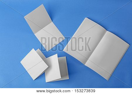 Blank brochure and booklets on blue background