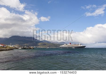 Qm2 In Front Of Ushuaia City