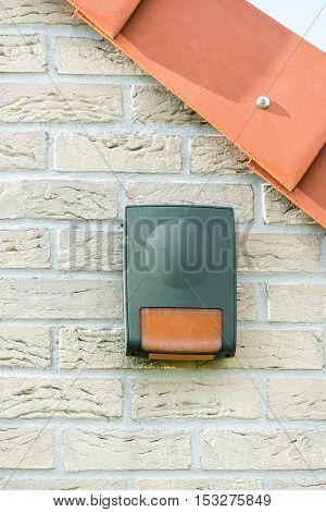 Alarm on a brick wall of house