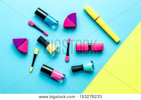 concept cosmetic set on blue and yellow background top view.