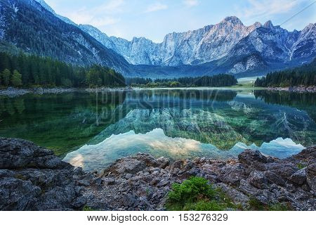 Early morning on the lake Fusine Julian Alps Italy