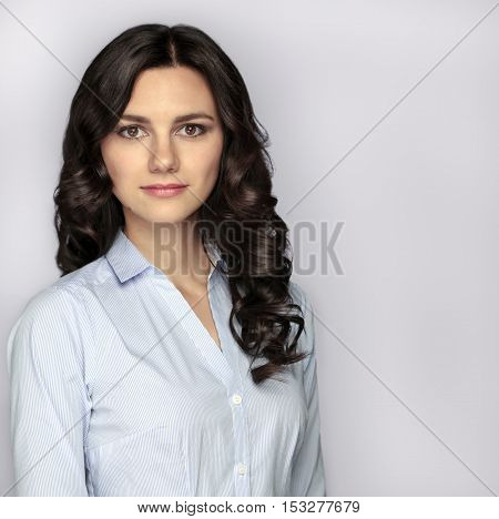 Brunette girl with long and shiny wavy hair. Female office workers. With copy space