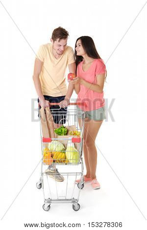 Happy couple with metal trolley isolated on white