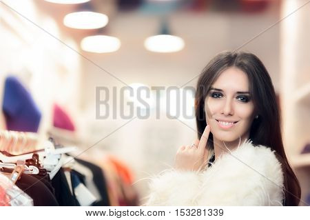 Shopping Woman Dressed in White Fur Coat in Fashion Store