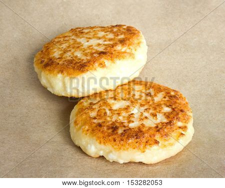 Cottage cheese pancakes on kraft paper. Food photo.