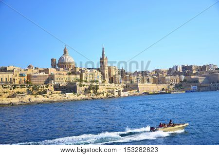 View of Valletta the capital city of Malta with motor boat
