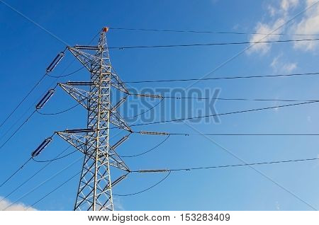 Power transmission tower against  the blue sky