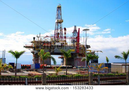 Drilling rig on the coast of Atlantic Ocean. Oil platform.
