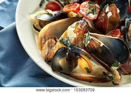 Plate of mussels in garlic sauce