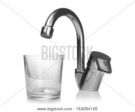 Empty glass and tap isolated on white. Water saving concept