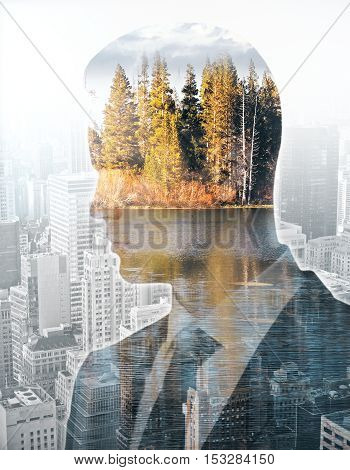 Businessman thinking about ecology on city background. Eco concept. Double exposure