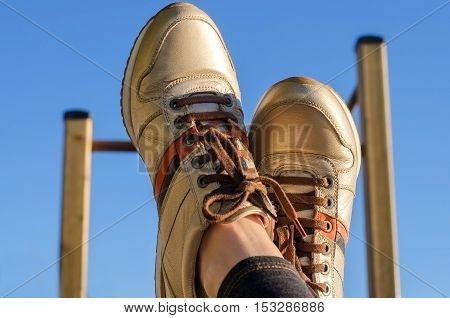 Selfie of sport shoes on blue sky