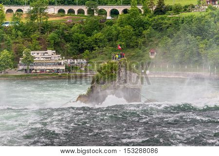 Neuhausen am Rheinfall Switzerland - May 24 2016: The Rhine Falls in Neuhausen am Rheinfall Schaffhausen Switzerland. The Rhine Falls is the largest waterfall in Europe.