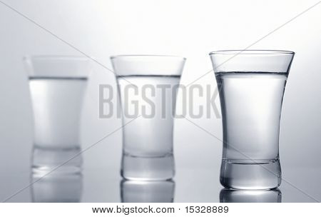Three vodka shots, shallow depth of field