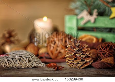 Composition of cone, anise and wicker decor on wooden background, close up view