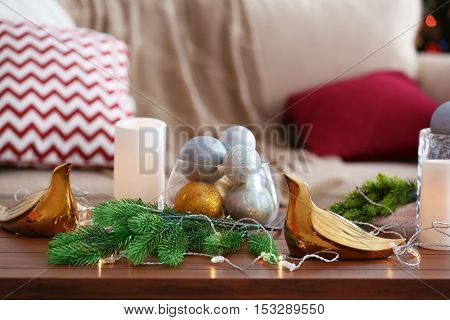 Decorative balls and lights  on table, closeup