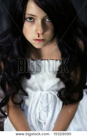 Nose bleeding - sad beautiful girl