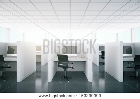 Front view of modern coworking office interior with computer monitors on desks. 3D Rendering