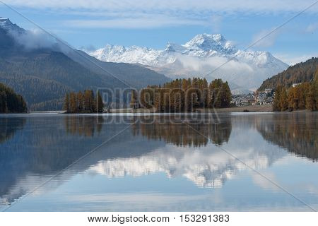 Autumn Landscape Of A Lake In The Swiss Alps Of The Engadine Valley