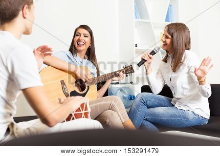 Friends enjoying playing guitar and singing together