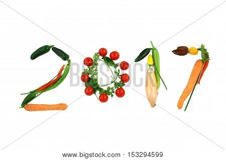 2017. Numbers 2016 and 2017. Happy vegan new year. healthy lifestyle transition. healthy vegan food. letters made of vegetables and meat. new year's resolution. concept. isolated on white background
