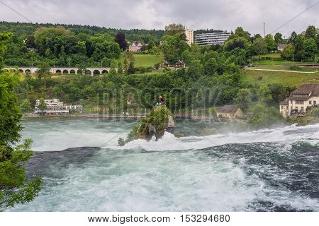 The Rhine Falls in Neuhausen am Rheinfall Schaffhausen Switzerland. The Rhine Falls is the largest waterfall in Europe.