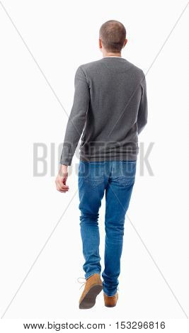 Back view of going  handsome man. walking young guy . Rear view people collection.  backside view of person.  Isolated over white background. A guy in a gray sweater walking waving his arms.