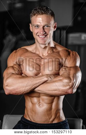 Handsome Muscular Bodybuilder Man Doing Exercises In Gym