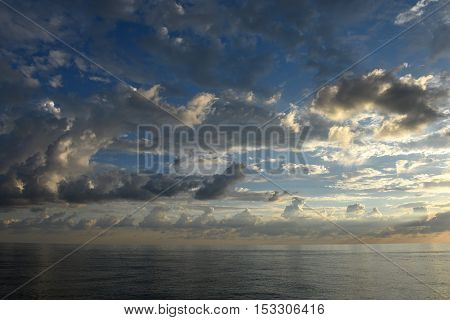 Beautiful scenic clouds over the sea at sunset