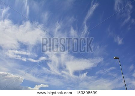 A mixture of different cloud types including cumulus and cirrus near the north east Italian town of Cividale del Friuli in late summer.